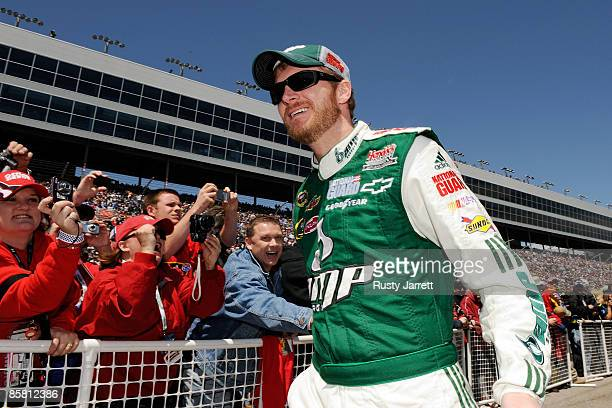 Dale Earnhardt Jr driver of the National Guard/AMP Energy Chevrolet shakes hands with fans during driver intros for the NASCAR Sprint Cup Series...