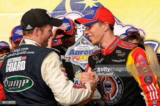 Dale Earnhardt Jr driver of the National Guard/Amp Energy Chevrolet congratulates Brad Keselowski driver of the Miccosukee Chevrolet in victory lane...