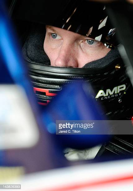 Dale Earnhardt Jr., driver of the National Guard/Diet Mountain Dew Chevrolet, sits in his car in the garage area during practice for the NASCAR...