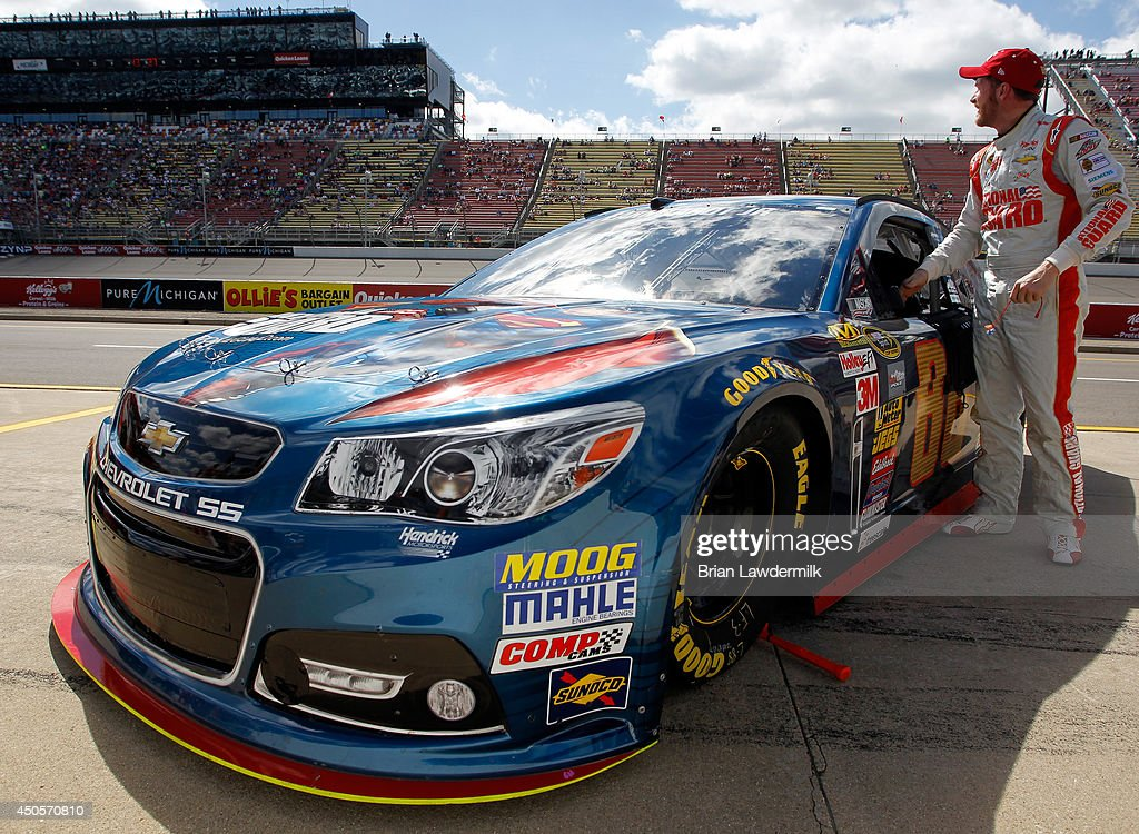 Dale Earnhardt Jr., driver of the #88 National Guard/Superman Chevrolet, stands on the grid during qualifying for the NASCAR Sprint Cup Series Quicken Loans 400 at Michigan International Speedway on June 13, 2014 in Brooklyn, Michigan.