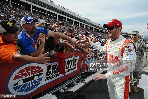 Dale Earnhardt Jr driver of the National Guard/Superman Chevrolet greets fans during prerace ceremonies for the NASCAR Sprint Cup Series CocaCola 600...