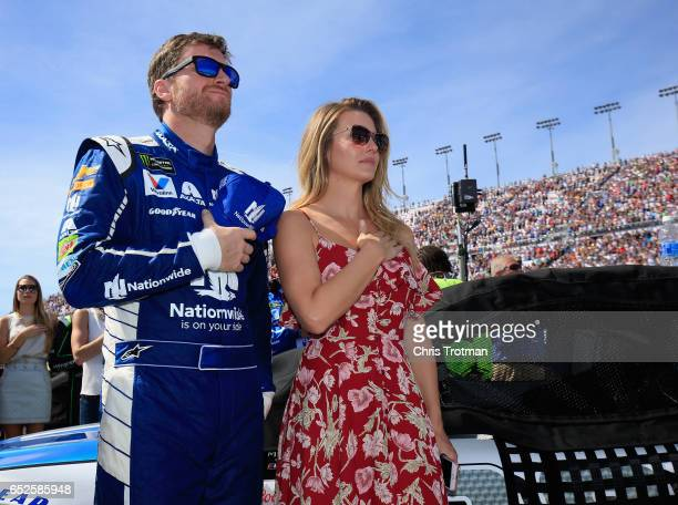 Dale Earnhardt Jr driver of the Nationwide Chevrolet and his wife Amy stand on the grid prior to the Monster Energy NASCAR Cup Series Kobalt 400 at...