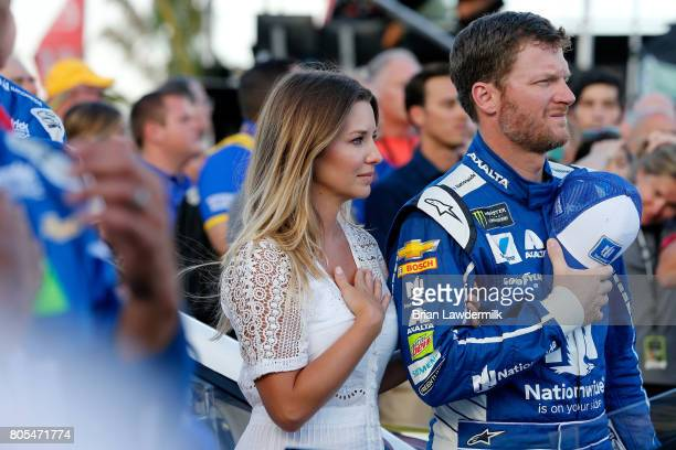 Dale Earnhardt Jr driver of the Nationwide Chevrolet and his wife Amy stand on the grid prior to the Monster Energy NASCAR Cup Series 59th Annual...