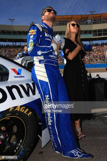 Dale Earnhardt Jr driver of the Nationwide Chevrolet and his wife Amy stand during the national anthem prior to the Monster Energy NASCAR Cup Series...