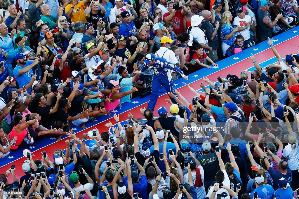 Dale Earnhardt Jr., driver of the #88 Nationwide Chevrolet, greets fans as he is introduced prior to the Monster Energy NASCAR Cup Series 59th Annual Coke Zero 400 Powered By Coca-Cola at Daytona International Speedway on July 1, 2017 in Daytona Beach, Florida.