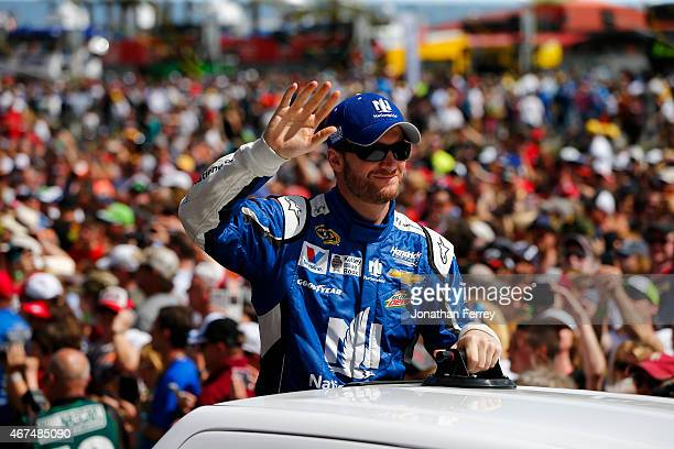 Dale Earnhardt Jr driver of the Nationwide Chevrolet greets fans during the NASCAR Sprint Cup Series 57th Annual Daytona 500 at Daytona International...