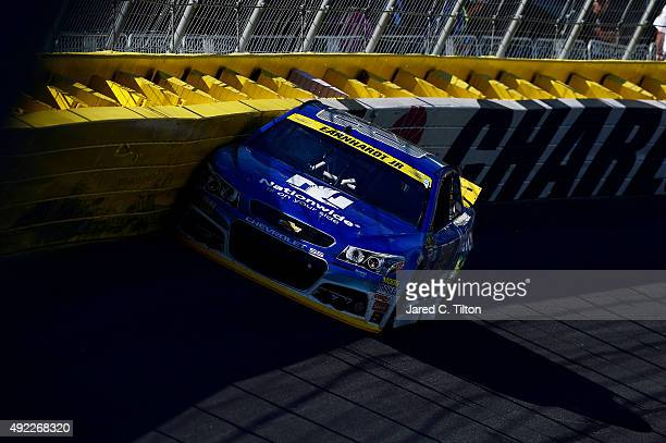Dale Earnhardt Jr driver of the Nationwide Chevrolet hits the wall during the NASCAR Sprint Cup Series Bank of America 500 at Charlotte Motor...