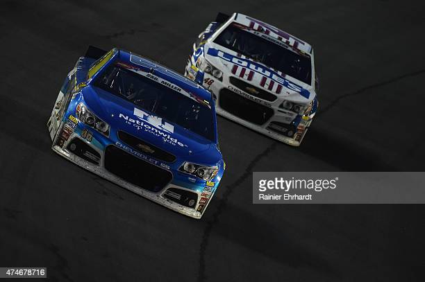 Dale Earnhardt Jr driver of the Nationwide Chevrolet leads Jimmie Johnson driver of the Lowe's Patriotic Chevrolet during the NASCAR Sprint Cup...