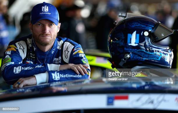 Dale Earnhardt Jr driver of the Nationwide Chevrolet looks on during practice for the Monster Energy NASCAR Cup Series Apache Warrior 400 presented...