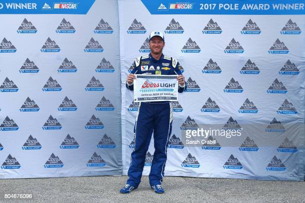 Dale Earnhardt Jr driver of the Nationwide Chevrolet poses with the Coors Light Pole Award after qualifying in the pole position for the Monster...