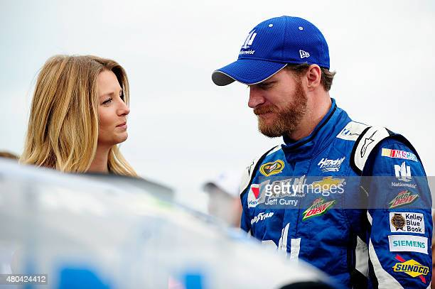 Dale Earnhardt Jr driver of the Nationwide Chevrolet right takes part in prerace ceremonies with fiancee Amy Reimann prior to the NASCAR Sprint Cup...