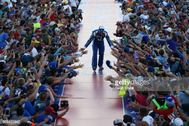 Dale Earnhardt Jr driver of the Nationwide Chevrolet shakes hands with fans on stage before the Monster Energy NASCAR Cup Series 59th Annual Coke...