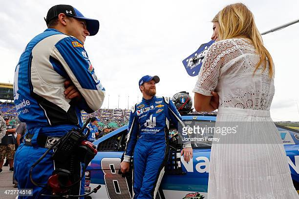 Dale Earnhardt Jr driver of the Nationwide Chevrolet speaks with his crew chief Greg Ives and his girlfriend Amy Reimann on pit road before the start...