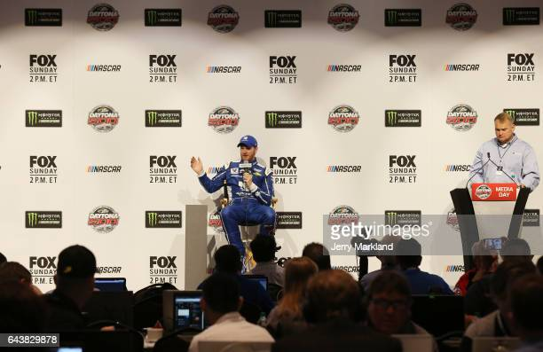 Dale Earnhardt Jr driver of the Nationwide Chevrolet speaks with the media during the Daytona 500 Media Day at Daytona International Speedway on...
