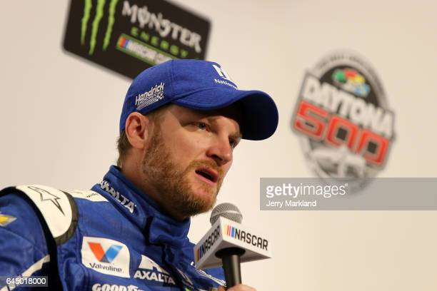 Dale Earnhardt Jr driver of the Nationwide Chevrolet speaks with the media without a Monster Energy NASCAR Cup Series patch on his firesuit during...