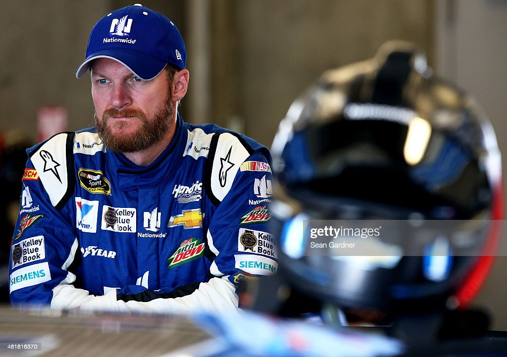 Dale Earnhardt Jr., driver of the #88 Nationwide Chevrolet, stands in the garage during practice for the NASCAR Sprint Cup Series Crown Royal Presents the Jeff Kyle 400 at the Brickyard at Indianapolis Motorspeedway on July 24, 2015 in Indianapolis, Indiana.