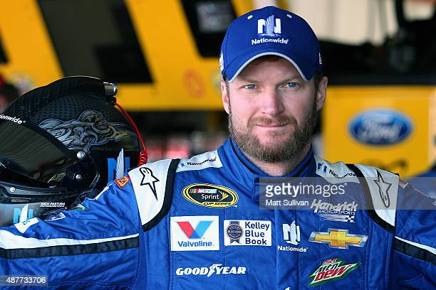 Dale Earnhardt Jr driver of the Nationwide Chevrolet stands in the garage area during practice for the NASCAR Sprint Cup Series Federated Auto Parts...