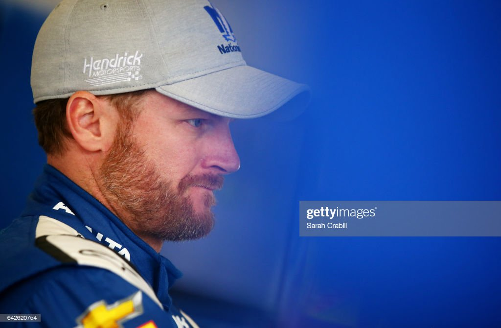 Dale Earnhardt Jr., driver of the #88 Nationwide Chevrolet, stands in the garage area during practice for the Monster Energy NASCAR Cup Series 59th Annual DAYTONA 500 at Daytona International Speedway on February 18, 2017 in Daytona Beach, Florida.