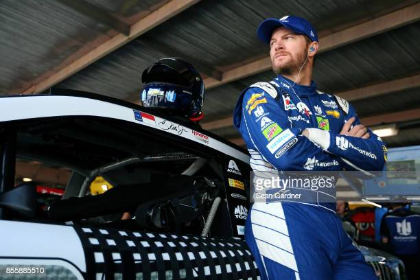 Dale Earnhardt Jr driver of the Nationwide Chevrolet stands in the garage area during practice for the Monster Energy NASCAR Cup Series Apache...
