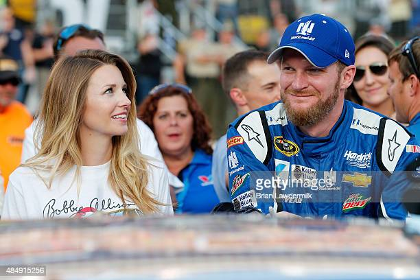 Dale Earnhardt Jr driver of the Nationwide Chevrolet stands on the grid with his fiance Amy Reimann prior to the NASCAR Sprint Cup Series IRWIN Tools...