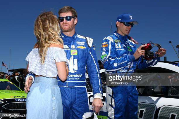 Dale Earnhardt Jr driver of the Nationwide Chevrolet stands on the grid with his wife Amy Reimann prior to the Monster Energy NASCAR Cup Series GEICO...
