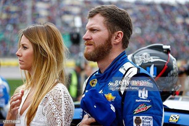 Dale Earnhardt Jr driver of the Nationwide Chevrolet stands with his girlfriend Amy Reimann during the national anthem ahead of the NASCAR Sprint Cup...