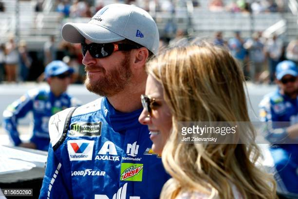 Dale Earnhardt Jr driver of the Nationwide Chevrolet stands with his wife Amy on the grid prior to the Monster Energy NASCAR Cup Series Overton's 301...