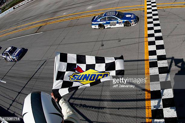 Dale Earnhardt Jr driver of the Nationwide Chevrolet takes the checkered flag to win the NASCAR Sprint Cup Series GEICO 500 at Talladega...