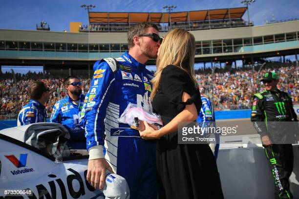 Dale Earnhardt Jr driver of the Nationwide Chevrolet talks with Amy Earnhardt as he prepares to drive during the Monster Energy NASCAR Cup Series...