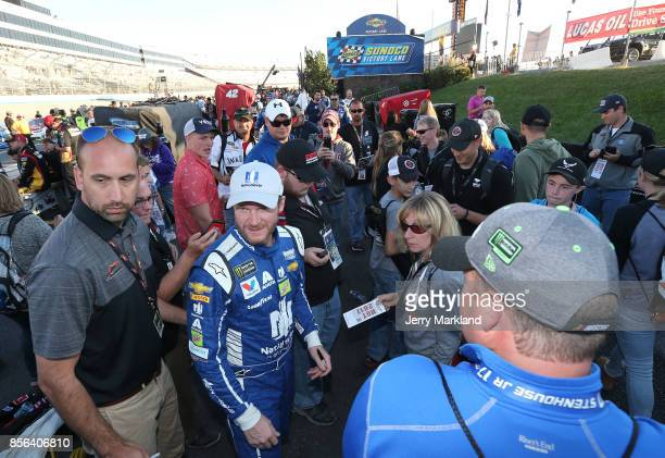 Dale Earnhardt Jr driver of the Nationwide Chevrolet walks down pit road following the Monster Energy NASCAR Cup Series Apache Warrior 400 presented...
