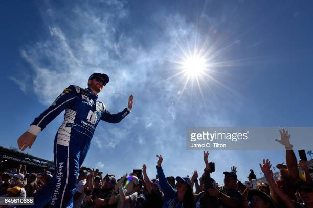 Dale Earnhardt Jr driver of the Nationwide Chevrolet waves to the crowd after being introduced prior to the 59th Annual DAYTONA 500 at Daytona...