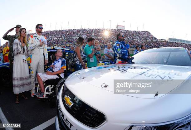 Dale Earnhardt Jr driver of the Nationwide Children's Hospital Chevrolet is seen with his wife Amy before the Monster Energy NASCAR Cup Series Quaker...