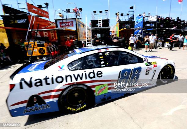 Dale Earnhardt Jr driver of the Nationwide Patriotic Chevrolet drives through the garage during practice for the Monster Energy NASCAR Series...