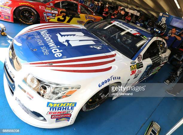 Dale Earnhardt Jr driver of the Nationwide Patriotic Chevrolet gets into his car during practice for the Monster Energy NASCAR Series CocaCola 600 at...