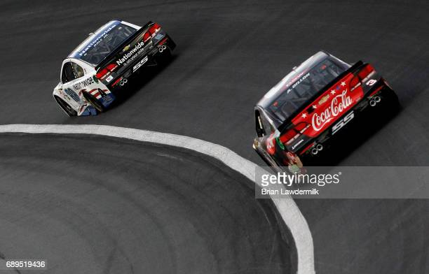 Dale Earnhardt Jr driver of the Nationwide Patriotic Chevrolet leads Austin Dillon driver of the DOW Salutes Veterans Chevrolet during the Monster...
