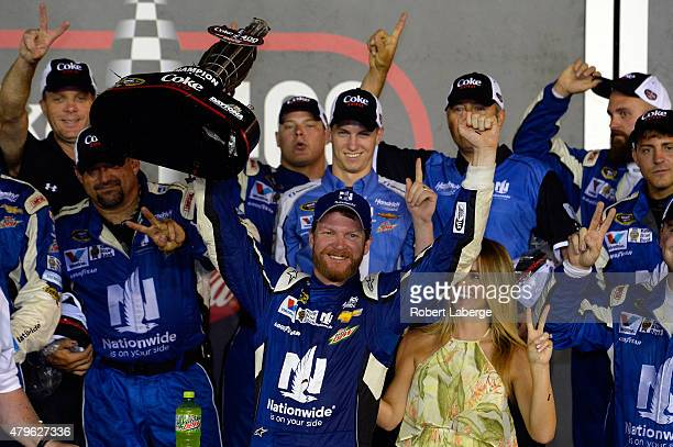 Dale Earnhardt Jr driver of the Nationwide Stars and Stripes Chevrolet celebrates in Victory Lane after winning the NASCAR Sprint Cup Series Coke...