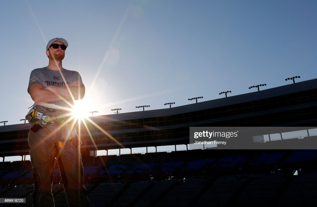Dale Earnhardt Jr., driver of the #88 Nationwide/Justice League Chevrolet, stands on the grid during Salute To Veterans Qualifying Days Fueled by Texas Lottery for the Monster Energy NASCAR Cup Series AAA Texas 500 at Texas Motor Speedway on November 3, 2017 in Fort Worth, Texas.