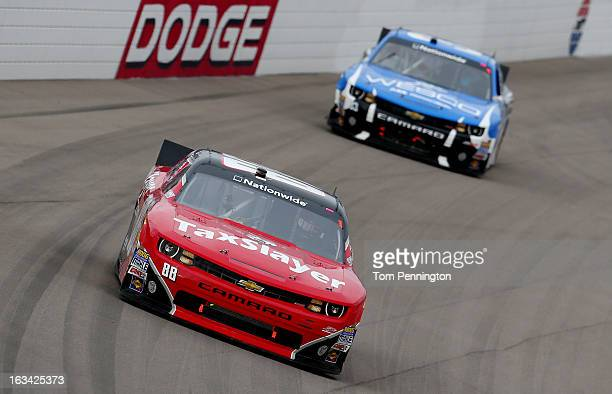 Dale Earnhardt Jr driver of the TaxSlayercom Chevrolet leads Ty Dillon driver of the WESCO Chevrolet during the NASCAR Nationwide Series Sam's Town...