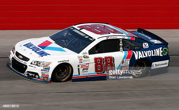 Dale Earnhardt Jr driver of the Valvoline Chevrolet practices for the NASCAR Sprint Cup Series Bojangles' Southern 500 at Darlington Raceway on...