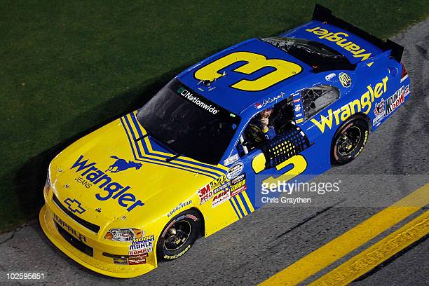 Dale Earnhardt Jr driver of the Wrangler Chevrolet celebrates after winning the NASCAR Nationwide Series Subway Jalapeno 250 at Daytona International...