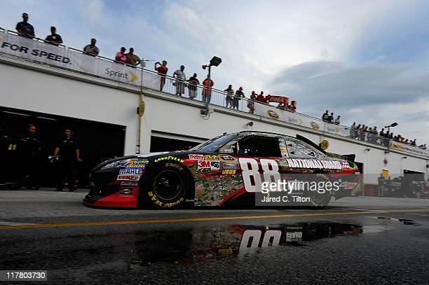Dale Earnhardt Jr drives his National Guard Heritage/AMP Energy Drink Chevrolet through the garage during practice for the NASCAR Sprint Cup Series...