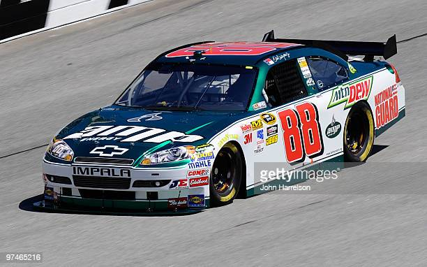 Dale Earnhardt Jr drives the AMP Energy/National Guard Chevrolet during practice for the NASCAR Sprint Cup Series Kobalt Tools 500 at Atlanta Motor...