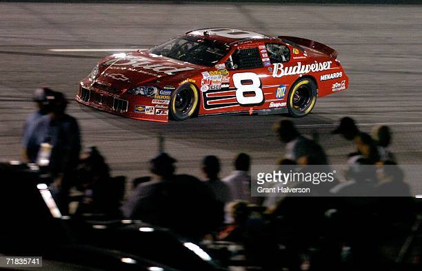 Dale Earnhardt Jr drives the Budweiser Chevrolet as fans watch the action during the NASCAR Nextel Cup Series Chevy Rock Roll 400 on September 9 2006...