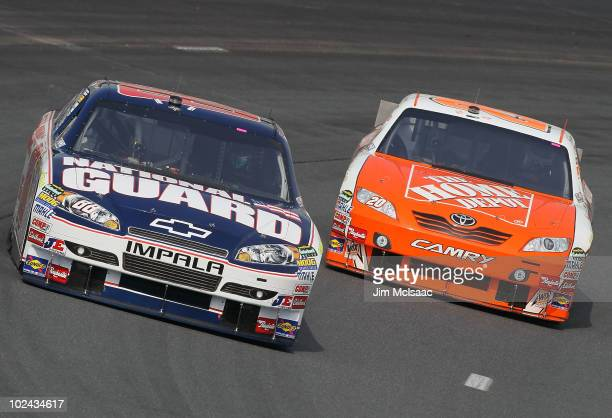 Dale Earnhardt Jr drives the National Guard/AMP Energy Chevrolet ahead of Joey Logano driver of the Home Depot Toyota during practice for the NASCAR...