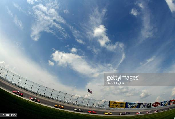 Dale Earnhardt Jr, driving the Budweiser Chevrolet, leads Jeremy Mayfield in the Evernham Motorsports Dodge and the field during the NASCAR Nextel...