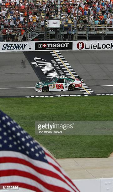 Dale Earnhardt Jr driving the National Guard/AMP Energy Chevrolet drives during a caution lap at the end of the NASCAR Sprint Cup Series Lifelock 400...