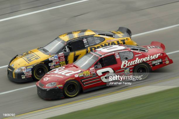 Dale Earnhardt Jr in the Budweiser Chevrolet passes Matt Kenseth in the Dewalt Ford for the lead during the NASCAR Winston Cup Aaron's 499 on April 6...