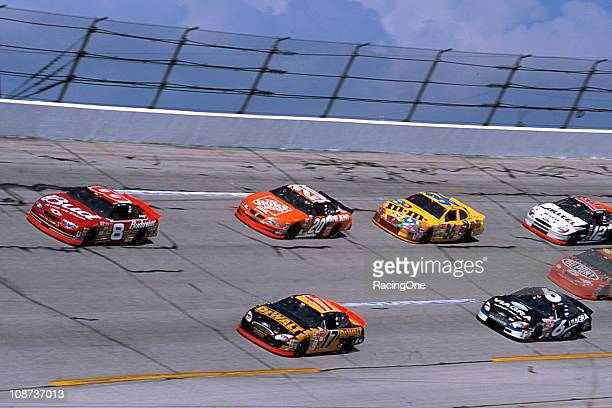 Dale Earnhardt Jr leads the field on his way to winning the EA Sports 500 NASCAR Cup race at Talladega Superspeedway giving him a sweep of the...