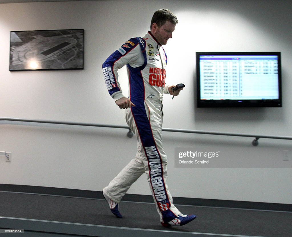 Dale Earnhardt, Jr., leaves the media center stage after a press conference at Daytona International Speedway in Daytona Beach, Florida, Friday, January 11, 2013. Later in the day, Earnhardt, Jr., caused a 12-car pile-up during test trials at the track.