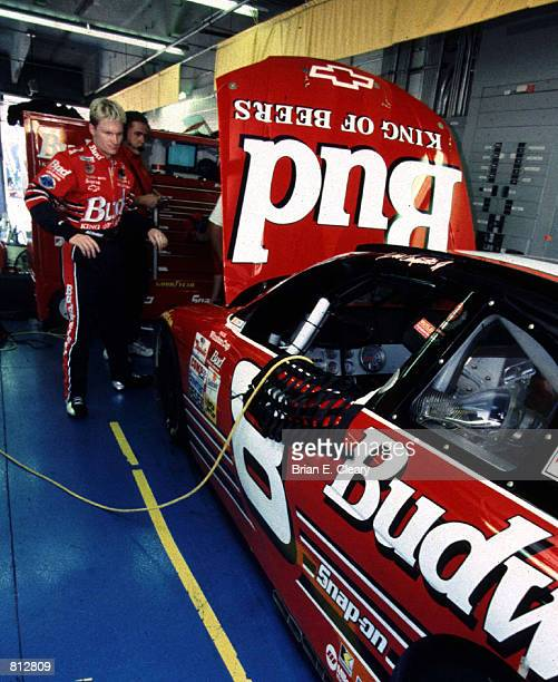 Dale Earnhardt Jr looks over his new ride at Lowe's Motor Speedway in Concord NC May 29 1999 Earnhardt Jr the 1998 Busch Series Champion made his...